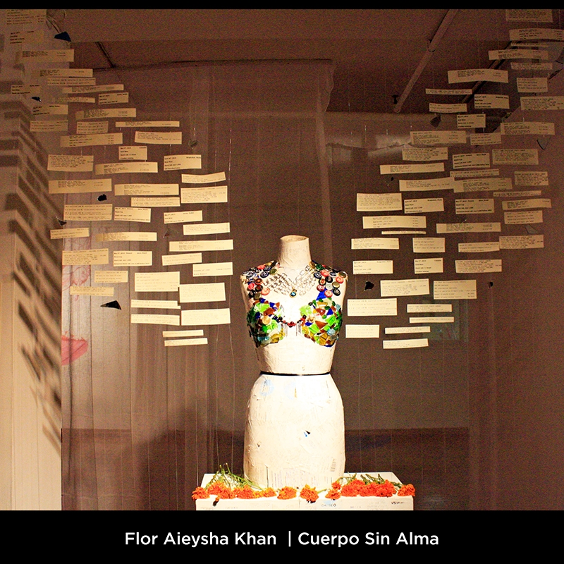Flor Aieysha Khan: Cuerpo Sin Alma. Every inch of the sculpture is covered in receipts of purchases that come to a grand total of nearly 20,000 dollars' worth of consumer goods. This altarpiece serves as an exploration and asks us to question: To what degree do we become what we consume?