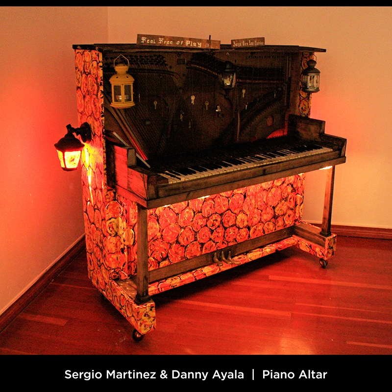 Sergio Martinez & Danny Ayala: Piano Altar. This piano altar is tribute to my grandfather who used piano as the medium to express his love for tango. We decided that the whole piece must be made out of materials found on streets and flea markets all over Oakland, CA in order to recreate and in some way recover the poetry and beauty of those forgotten notes.