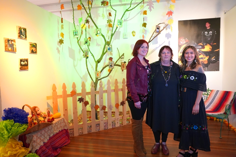 Artist Terrilee O'Rourke and daughters in front of her altar installation.
