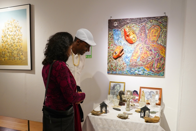 Artist Maykel Vargas showing his altar installation for the Orishas.