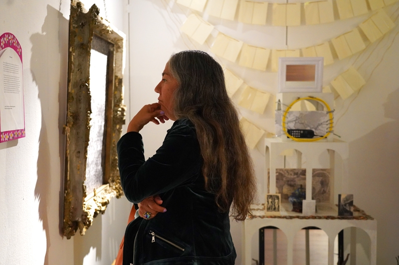 Guest looking at altar installation.