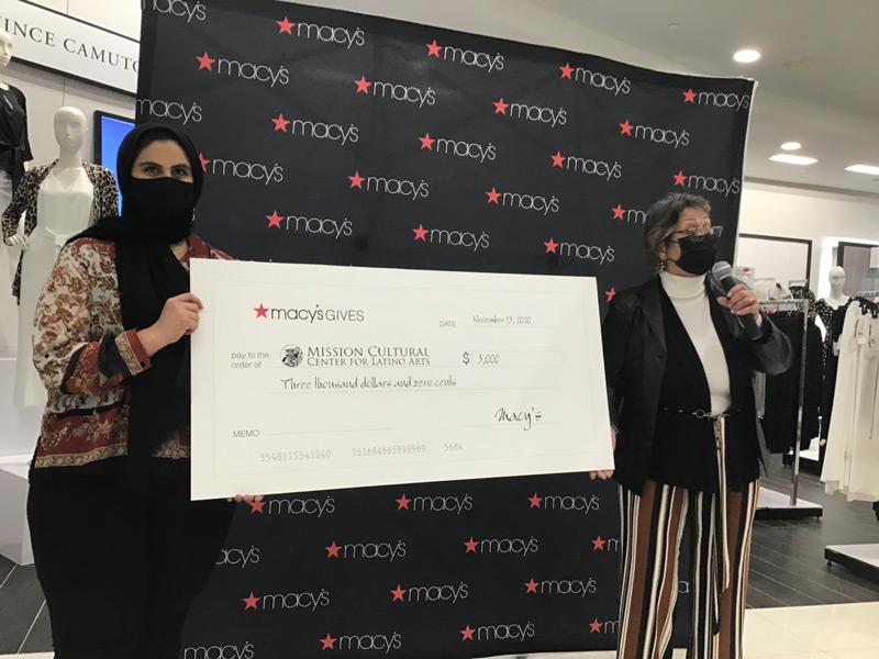 Manal Ayyad and Jennie Ramirez, holding large check for $3000